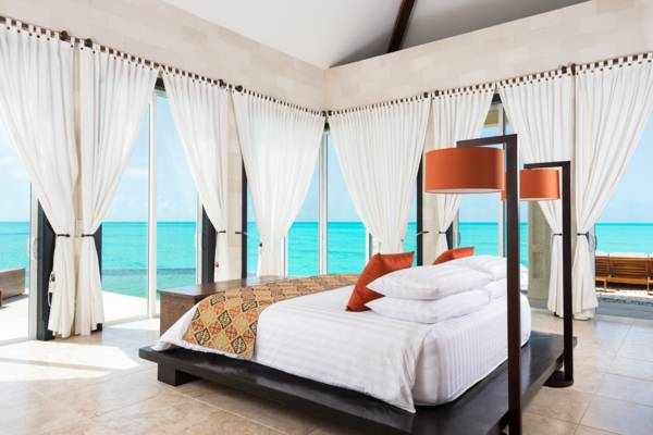 luxurious oceanfront master bedroom at Villa Balinese vacation home