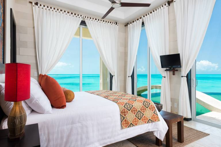 Guest oceanfront bedroom at Villa Balinese Turks and Caicos