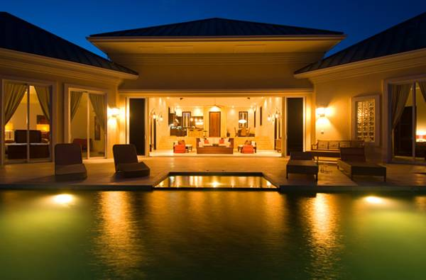 Villa Balinese poolside at night Turks and Caicos