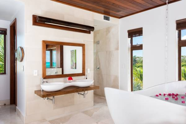 Kohler 4-way walk in shower and double vanty marble sinks at Beach Kandi on Grace Bay