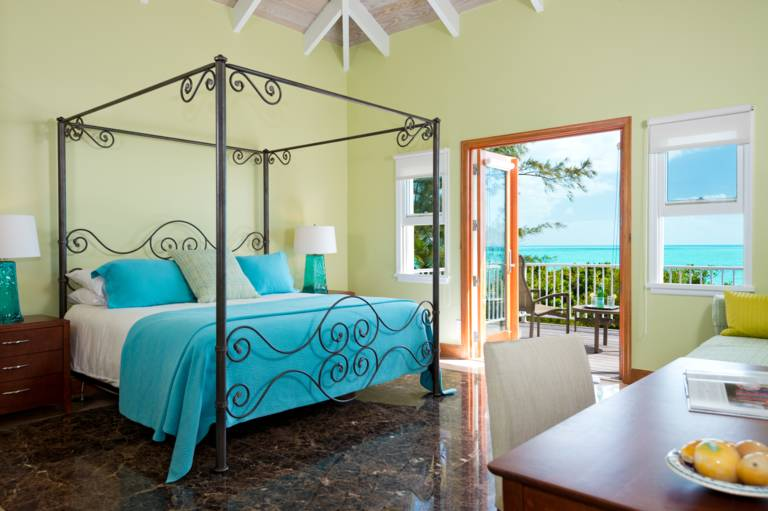 Oceanfront King master bedroom with private balcony at Casa Varnishkes, Providenciales