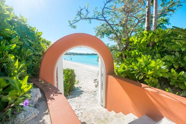 Gated beach entry at La Koubba estate villa in Providenciales