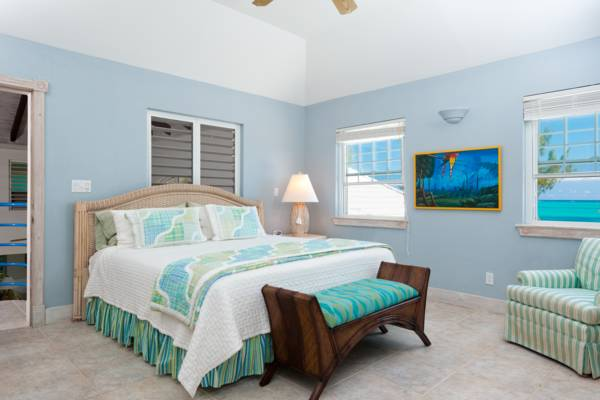 Beachfront King master bedroom at Serenity House Providenciales